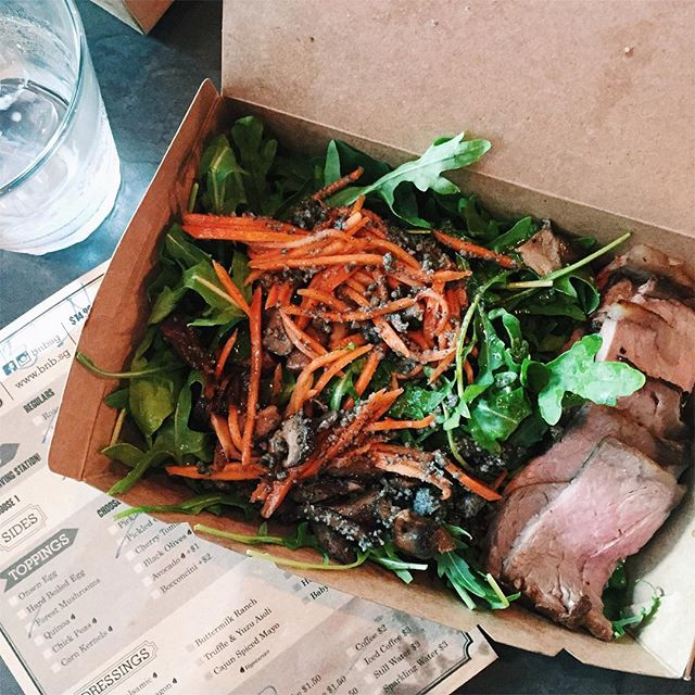 """Wish I had a better picture of this, but I gotta post it anyway because it was SO GOOD 😍 think I've found a new """"salad"""" place, thanks @faithwxyz for accompanying me 🙆🏼 a generous portion of roast beef on a bed of rocket leaves, drizzled with the most delicious honey balsamic dressing, topped with forest mushrooms, pickled carrots and...see those black specks?"""