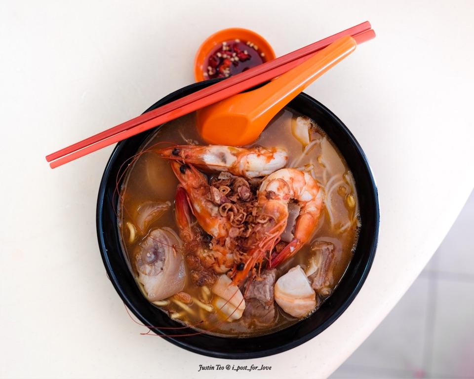 Prawn noodles with pork ribs, razar clams and pig's tail [$10]