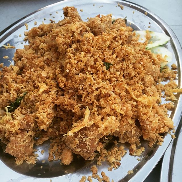 A beautiful mess of fried cereal on top of a bed of deep fried mantis prawn.