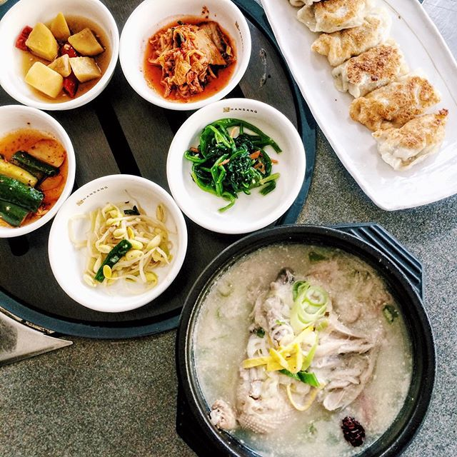 Homemade Korean ginseng chicken soup, gyoza, banchan.
