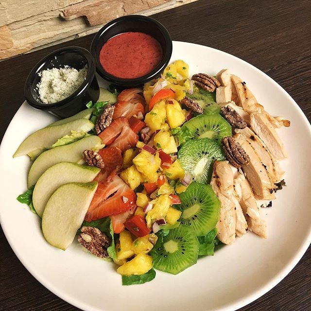 Harvest Fruit & Chicken Salad ($17.90++) Comes with succulent chicken breast on a bed of mixed salad, candied pecan, kiwi, strawberry, pear and pineapple salsa that is sprinkled with blue cheese crumble and 3 berry vinaigrette sauce!