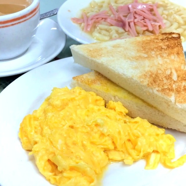 Loving HK's Capital Cafe, it's truffle scrambled eggs and milk tea.