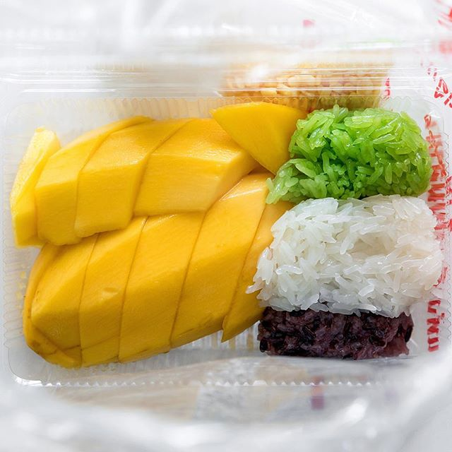 Incredibly sweet and juicy mango with three kinds of sticky rice ( white, black, and green color from pandan leaves).