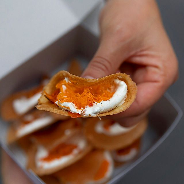 A local snack in front Rung Rueng noodle shop - Thai Crispy wafers with meringue cream, available in both savory and sweet versions.