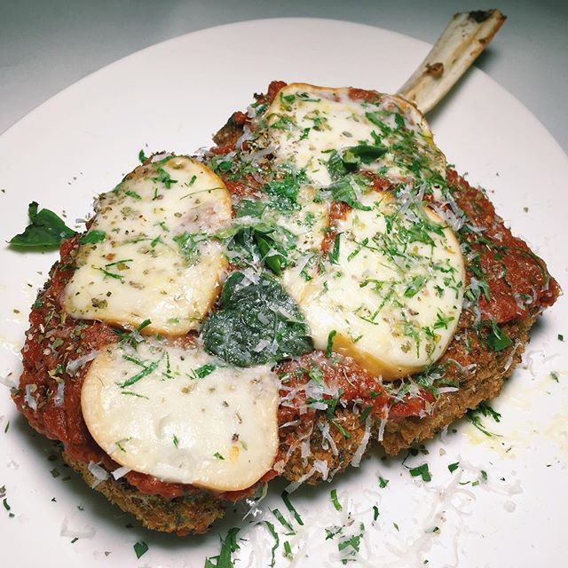 Signature veal chop parmigiana with classic red sauce and melting mozzarella from Angeleno.
