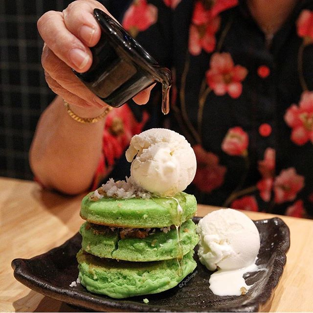 Pandan pancakes $8.50++ 🌴  3 thick and dense pandan pancakes topped with gula Melaka and coconut ice cream, served with honey.