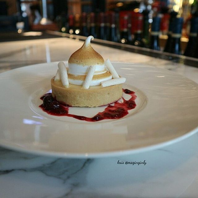 A tangy lemon curd and meringue sitting nicely on a buttery tart shell.