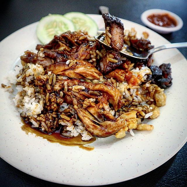 Orlulu (blacken) charsiew (roasted pork) and duck over rice.