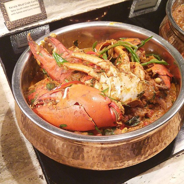Kerala Mud Crab Curry - Spicy South Indian Delicacy with Spices and Curry Leaves.
