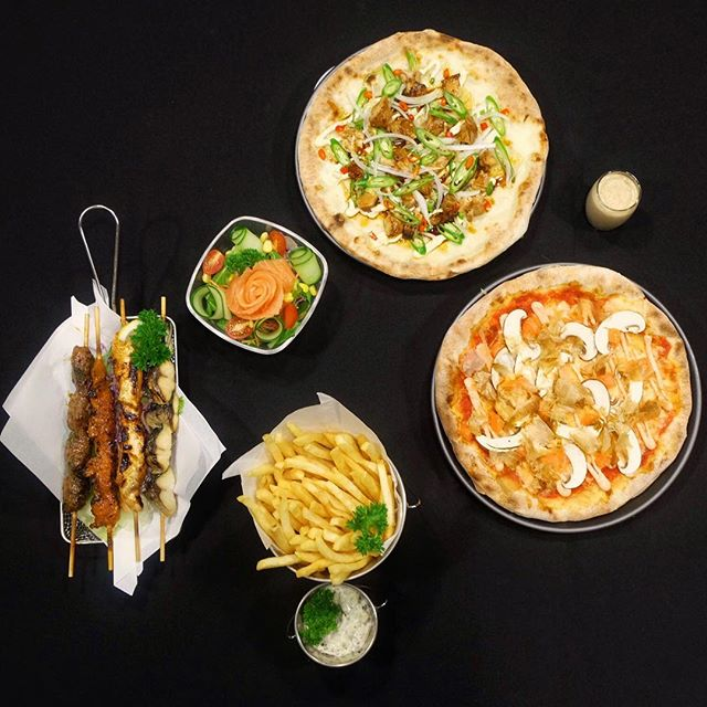 2 pizzas for $29.90 Skewers [$3.90] Salad [$3.80] Truffle fries [$8.80] .