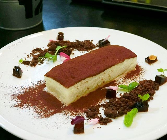 Pick Me Up - Specially for Tiramisu lovers Premium Arabica coffee-soaked ladyfinger with mascarpone cheese, garnished with coca dust, Kahlua jelly and chocolate soil on the side.