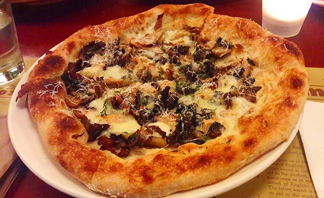 Crispy-crust, thin-based pizza that crackled just like the licking flames of the woodfire oven it was baked in.