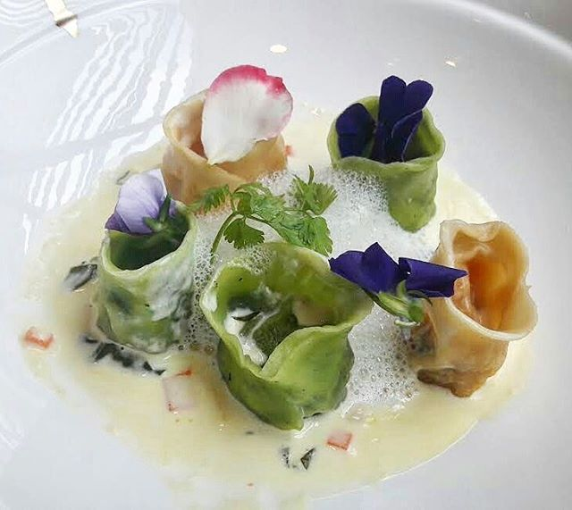 Duo Ravioli Platter - stunning pumpkin and spinach ravioli shaped like open tulips, with fragrant flower emulsion and cream sauce.