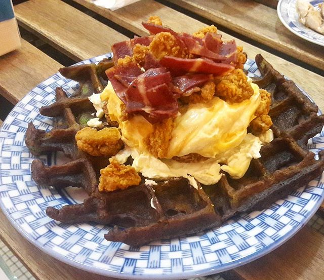 Saturdays brunching at OMT, polishing off a hugeass waffle topped with Popcorn Chicken, Cheese and Bacon.