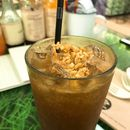 Iced Soda Tamarind Drink with Peanuts & Sesame Seeds.