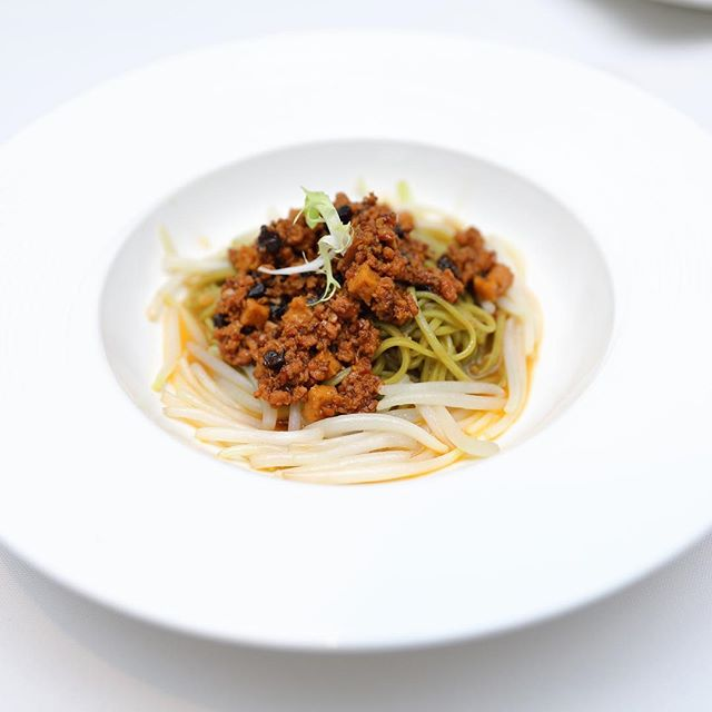 [Min Jiang, One-North] - Not to be missed is the Stewed Organic Green Tea Noodles with Black Garlic and Minced Pork ($10/pax).